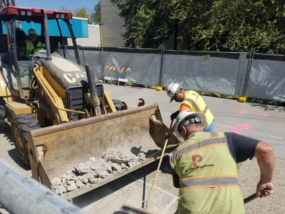 The construction workers begin revamping the path that leads to Portable Village at American River College on Aug. 28, 2018. (Photo by Ashley Hayes-Stone)