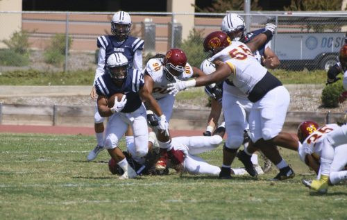 American River College running back, Evyn Holtz dodges the Sacramento City College defence in the first quarter of the game on Sept. 1, 2018. (Photo by Jennah Booth)