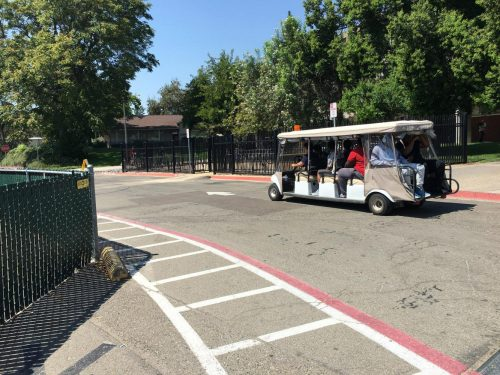 A shuttle transports students by Davies Hall at American River College on Sept. 11, 2018. (Photo by Hameed Zargry)