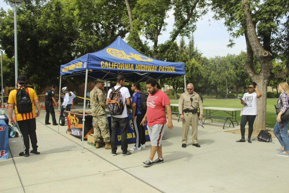 Tyler Heines, theater major, practices walking a straight line before wearing drunk simulation goggles, in front of the library at American River College on Sept. 12, 2018. The Los Rios Police Department and California Highway Patrol brought the goggles and tricycles to campus to raise awareness about the dangers of drunk driving. (Photo by Itzin Alpizar)