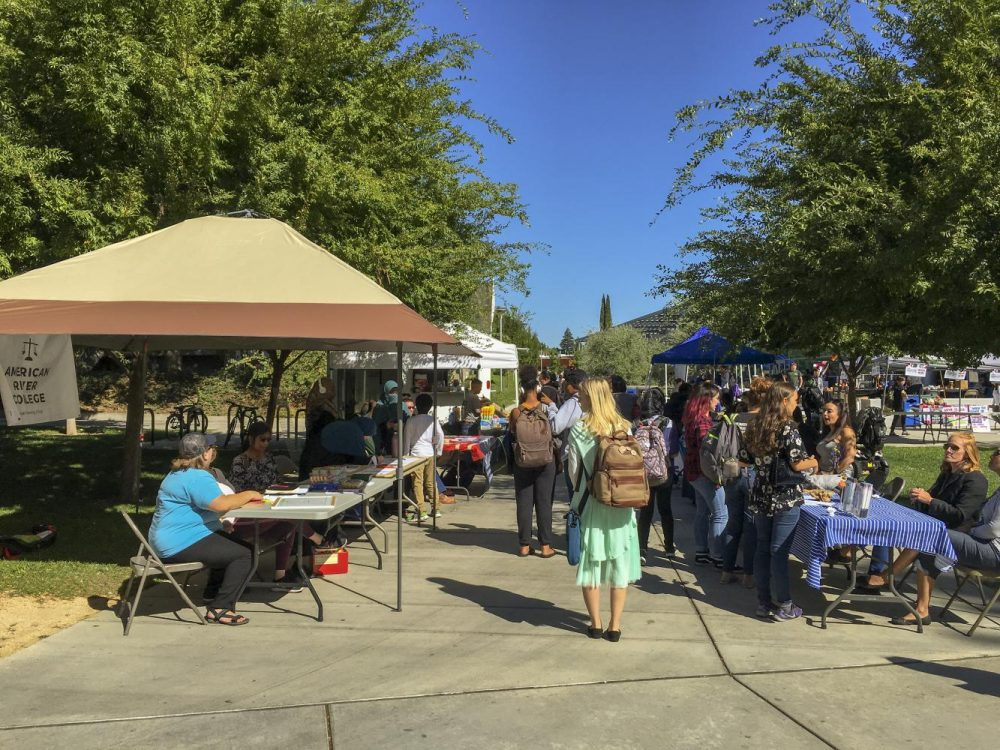 Students browse the booths near the Student Center on Welcome Day at American River College on Sept. 13, 2018. (Photo by Gabe Carlos)