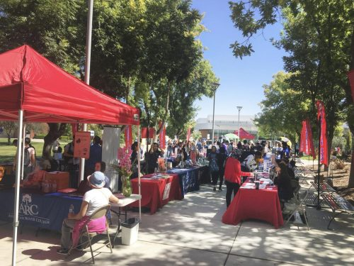 Students attend Transfer Day in the library quad at American River College on Sep. 17 2018. Universities set up booths to talk and supply information for students looking to further their education. (Photo by Hameed Zargry)