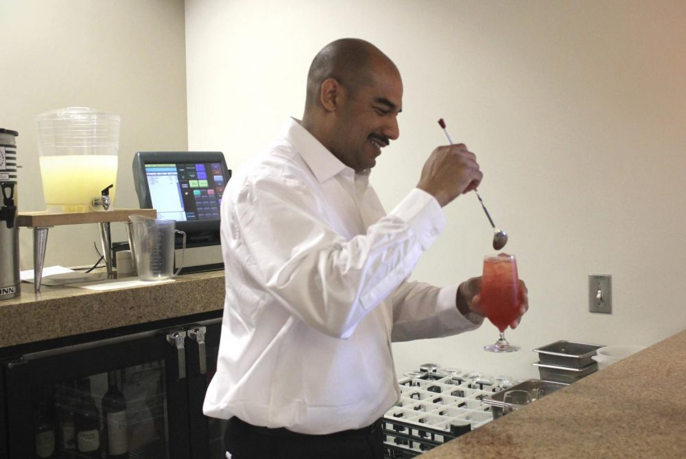 Phillip Bailey, a student in the Culinary Arts and Hospitality Management program, prepares Italian soda during a demonstration for reporters from the Current at the Oak Café's fall grand opening on Sept. 19, 2018 at American River College. The two non-alcoholic beverages are strawberry and cranapple lime, made with syrups that are prepared by students fresh each week. (Photo by Hannah Yates)