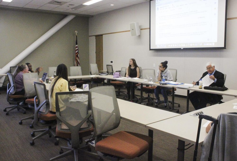 Members of the Associated Student Body Student Senate listen as Advisor Frankie Johnson gives feedback about the resolutions presented during a board meeting at American River College on Sept. 21, 2018. (Photo by Hannah Yates)