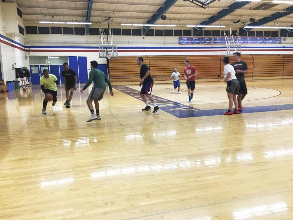 Students practice basketball on the court in the Kinesiology and Athletics building at American River College on Sept. 25, 2018. (Photo by Hameed Zargry)