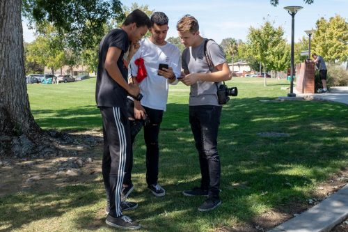 Students in Art Photography 305 (from left to right) Ryan White who studies education, Roberto Salinas, biology major, and Alex Chmil, computer science major, practice using their cameras in the field by American River College's theatre on Sept. 27. (Photo by Patrick Hyun Wilson)