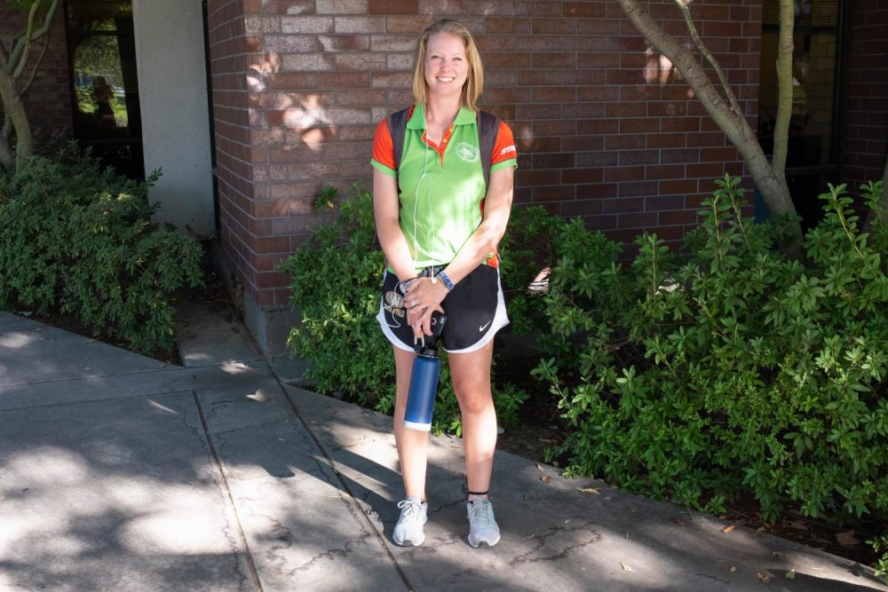 English major, Abby Scott walks along the pathway at American river college wearing a neon colored polo and workout shorts on Sept. 6.