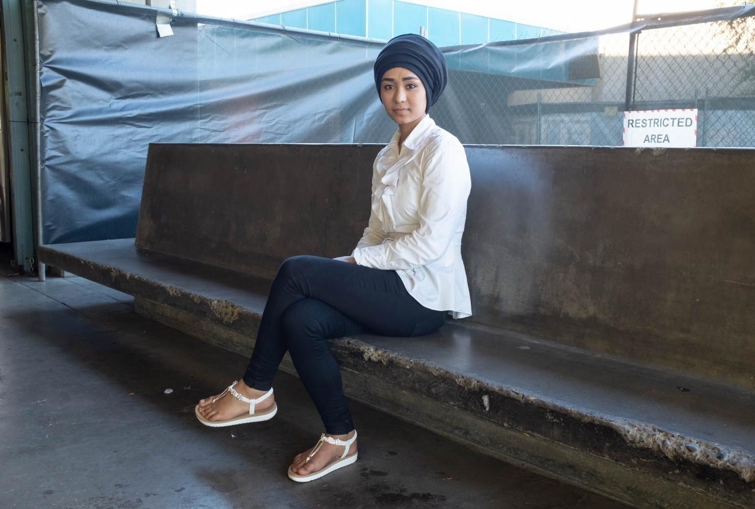"Physician's assistant major, Farzana Sultani wears a cultural scarf around her head, a white blouse, blue jeans, and white open toe sandals at American River College on Sept. 6. ""When I choose, I think, 'How can I mix the shoes, the jeans and my [head]scarf,'"" Sultani said. ""I wear my [scarf] everyday, I know a few different styles, sometimes I wear it like this, sometimes like that, and make it in a different style."" (Photo by Patrick Hyun Wilson)"