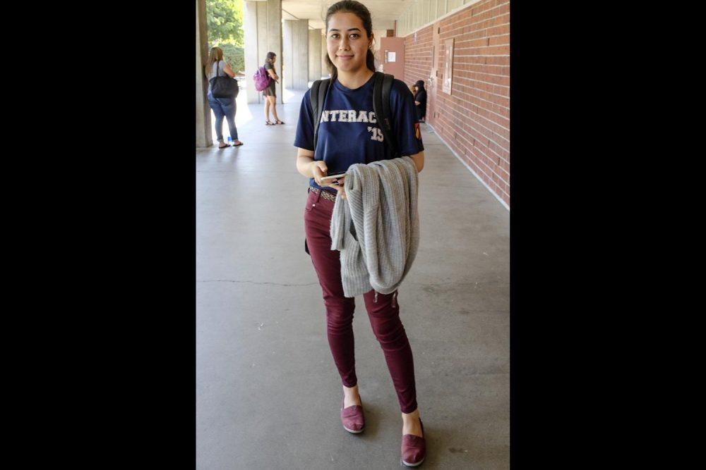 Biology major, Fatimah Yosefi walks the halls of Davies Hall dressed in American River College colors on Sept. 4.