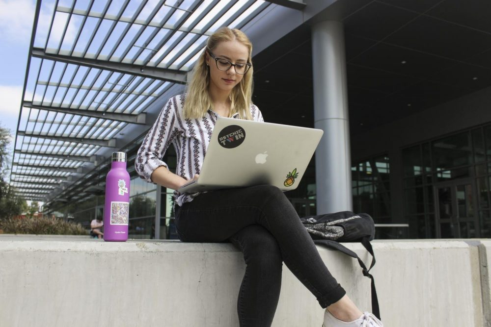 Environmental Studies major Julia Ackerman takes some time to study outside.