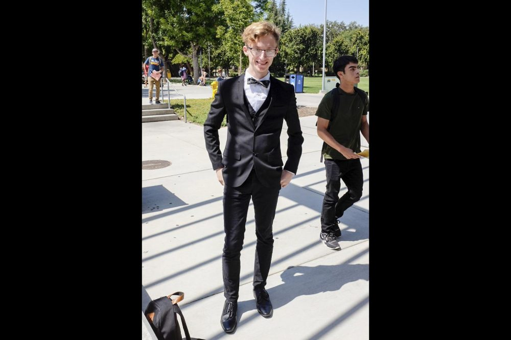 Computer tech major, Jacob McFatter wears a suit and bowtie at American River College for National Bowtie Day on Aug. 28.