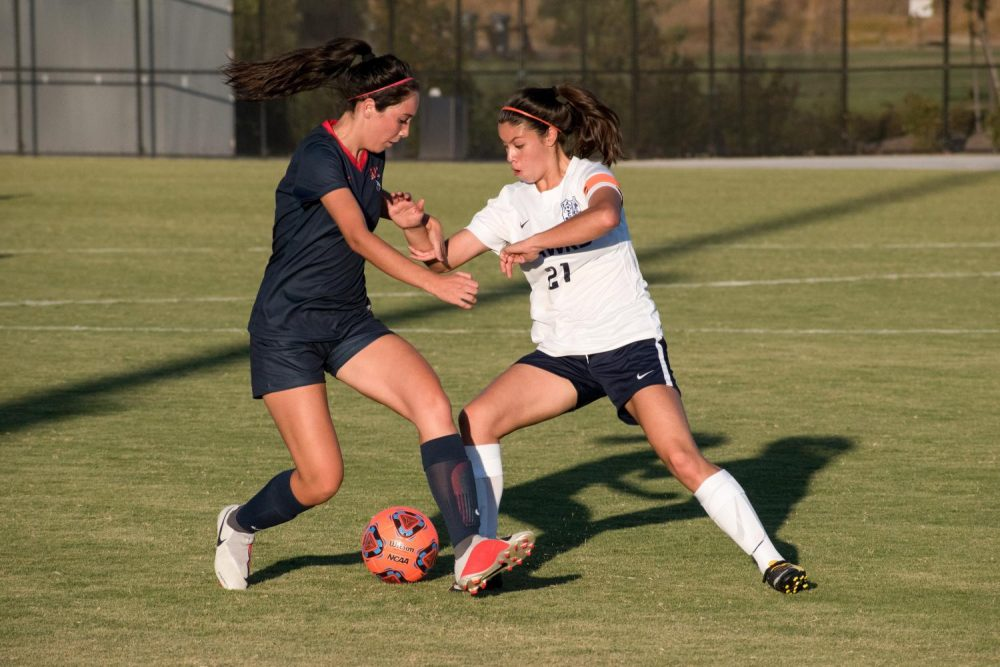 Forward Bianca Avilla faces off against a Cosumnes River College player during the game at American River College on Sept. 21 (Photo by Patrick Hyun Wilson)