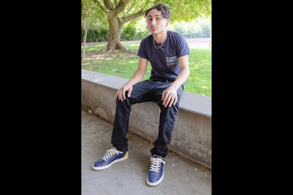 """Art major, Richard Gonzales wears all blue and a gold necklace at American River College on Sept. 4. """"Anything I see, if I like it, I'll probably wear it. At the mall or thrift stores, wherever I am. Downtown is a good place too,"""" Gonzales said. (Photo by Patrick Hyun Wilson)"""