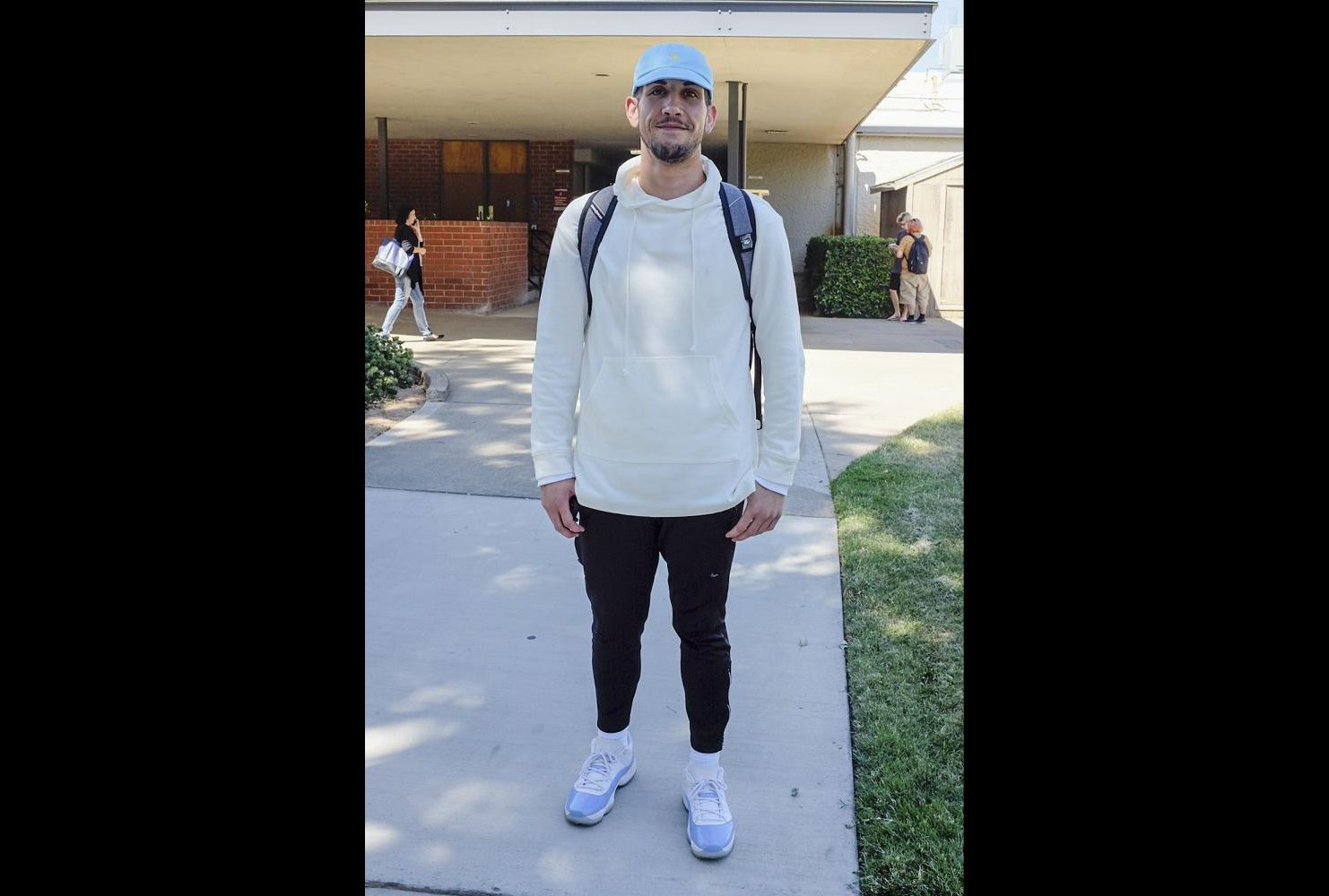 "Business Communications major, Vince Balafoutis wears an off-white sweatshirt, blue retro Jordans and a matching blue hat on Aug. 29. ""I only buy retro Jordans. I like stuff that people don't have, stuff that's not in the regular… My dad goes to Japan four times a year… he started bringing me back Bathing Ape from Japan [when I was young], it kind of screwed me,"" Balafoutis said. (Photo by Patrick hyun Wilson)"