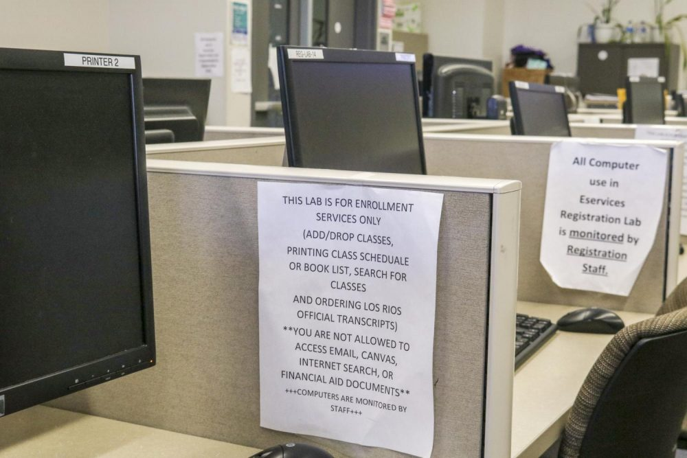 A sign instructing students of the services provided in the computer cubicles in the eServices building at American River College on Sept. 24, 2018. (Photo by Tracy Holmes)