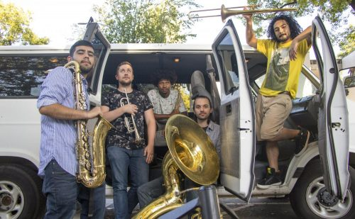 "City of Trees Brass Band members Isaac Negrete, Matt Voller, Devon Edmond, Ben Hillier and Miguel Recendez pose in front of their van named ""Ashley"" in front of Der Biergarten in Sacramento, on Sept. 6, 2018. (Photo by Ashley Hayes-Stone)"