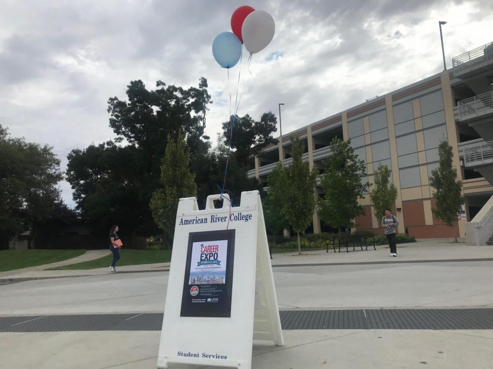 A sign stands near the parking garage to inform American River College students of the Career Expo event happening Oct. 3 and 4 in Comunity Rooms 1-4 from 10 a.m. to 2 p.m. (Photo by Alexis Warren)