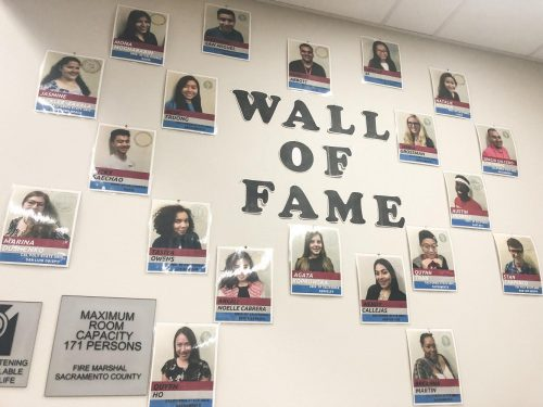 Photos of former student workers hang on the wall in the HUB at American River College on Oct. 2, 2018. (Photo by Alexus Hurtado)