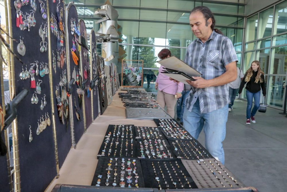 Local street artist Zafar Mahmood sells handmade jewelry to students infront of the cafetaria at American River College on Oct. 9, 2018. (photo by Hameed Zargry)