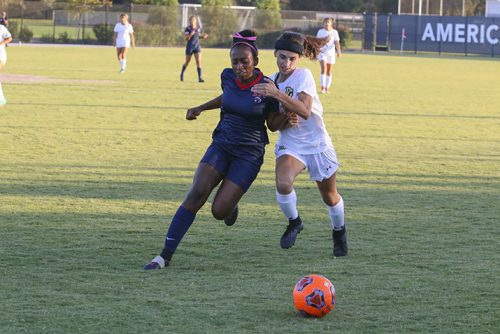 American River College forward Ka'liyah Bayless races a San Joaquin Delta player down line towards ARC's goal on Oct. 19, 2018. ARC lost the game, 2-0. (Photo by Jennah Booth)