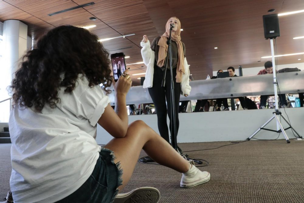 Raven Kauba sings at Tell It Tuesdays, which gives students an opportunity to express themsevles in the Student Center at American River College on Oct. 30, 2018. (Photo By Felix Oliveros)