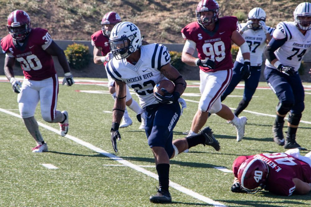 Running back Daniel Wright Jr. rushes past Sierra defenders during a game at Sierra College on Oct. 20, 2018. He scored 2 touchdowns for the Beavers during the game. (Photo by Patrick Hyun Wilson)