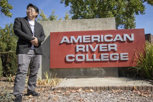 Phillip Kim, who is running for state senate, stands in front of the American River College sign on Sept. 27, 2018. (Photo by Ashley Hayes-Stone)