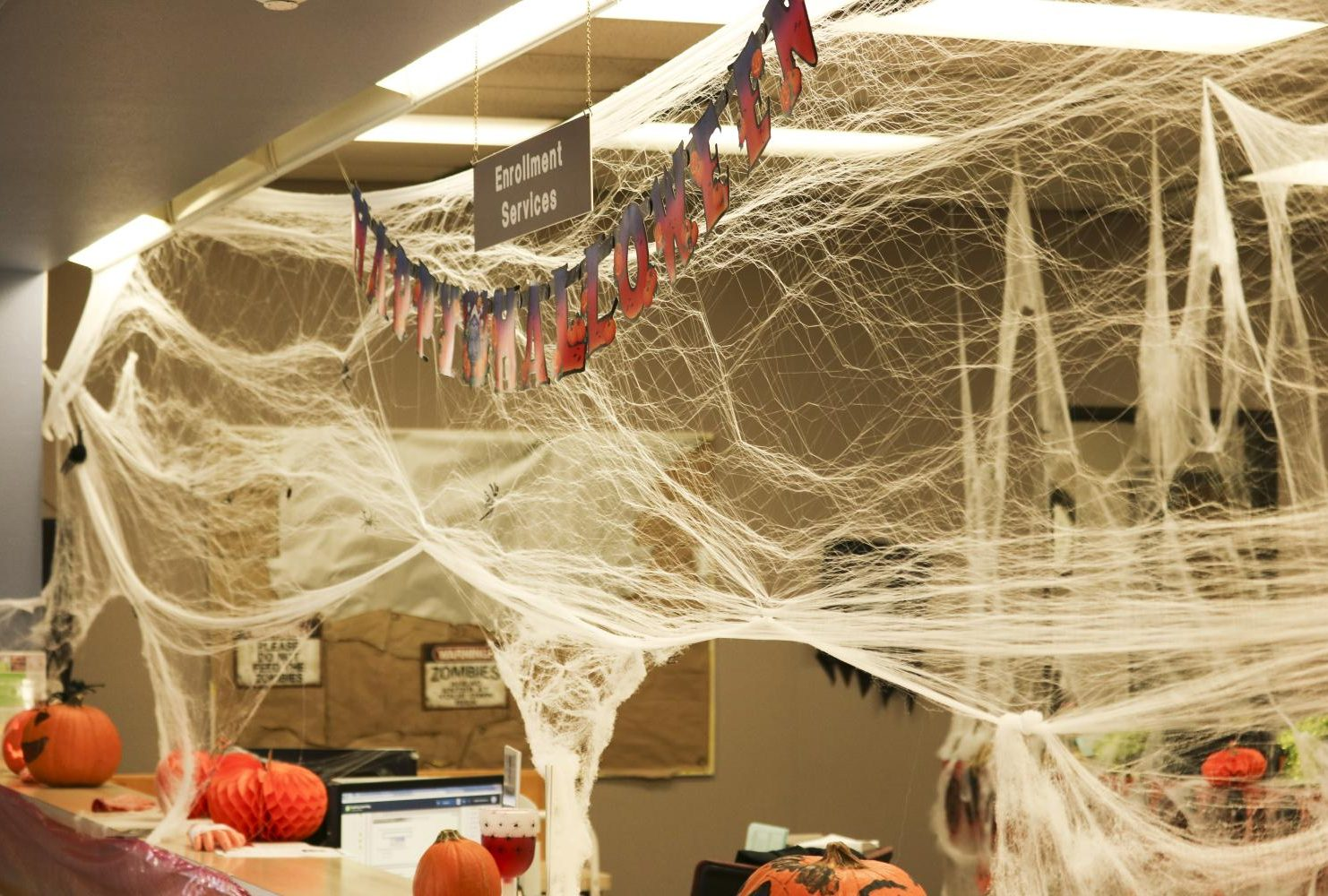 Enrollment Services located in the Administration Building decorates their department with the cobwebs and pumpkins. (Photo by Gabe Carlos)
