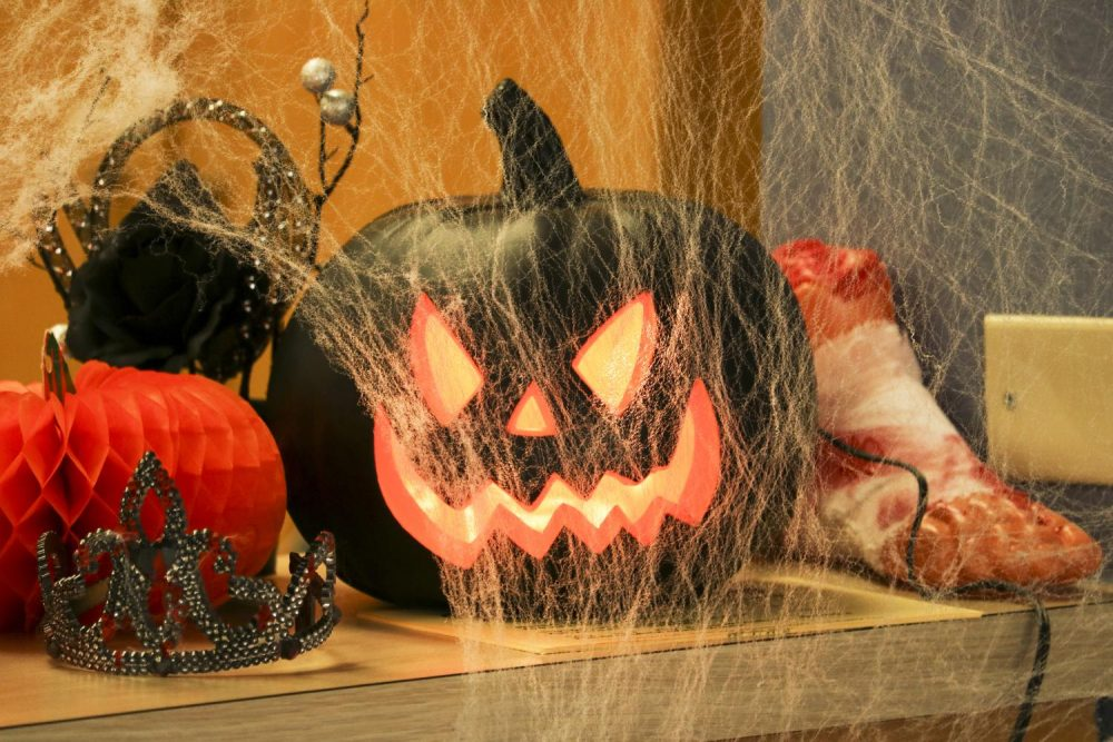 A jack-o-lantern sits on the Enrollment Services desk in the Administration building. (Photo by Gabe Carlos)
