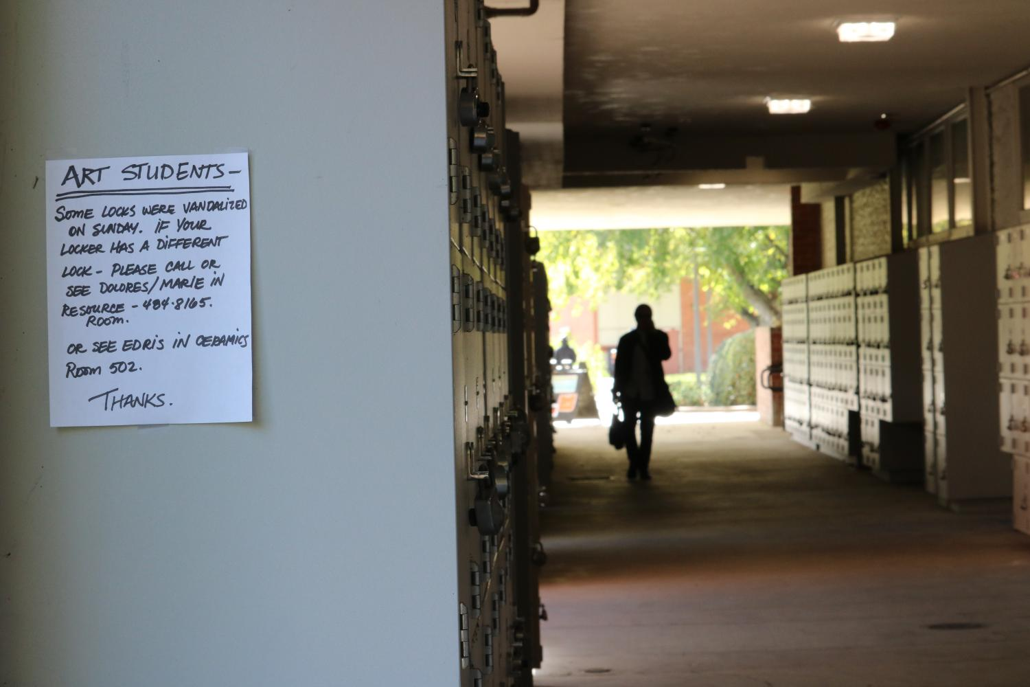 Signs were posted throughout the Fine and Applied Arts Department warning students about the lockers which were vandalized on the weekend of Oct. 12, 2018. (Photo courtesy of Luis Gael Jimenez)