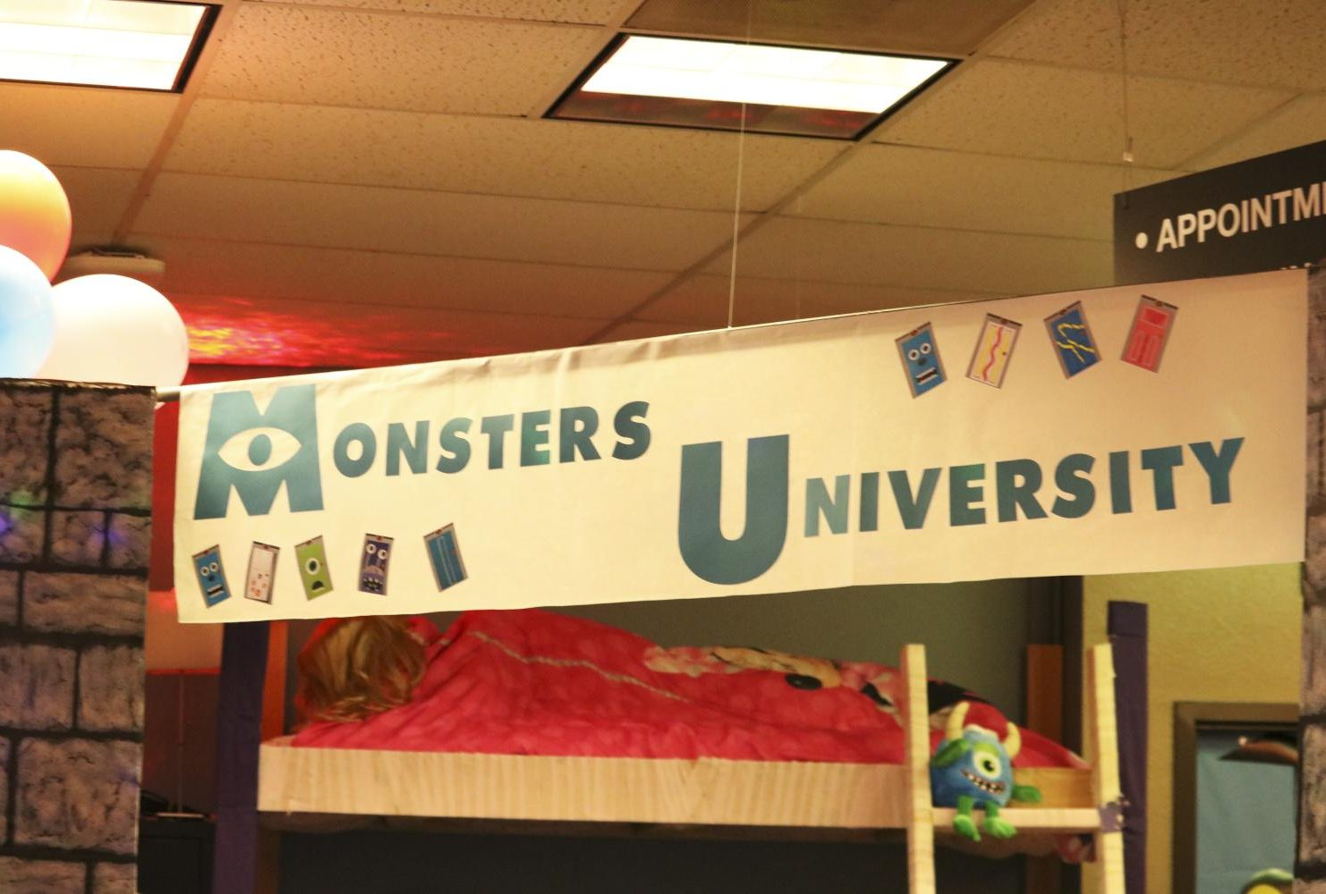 The Counselor's office is decorated as Monsters Inc. with photos of the main characters of the films on the wall, and doors hanging from the ceiling similar to the ones in the movie. (Photo by Gabe Carlos)