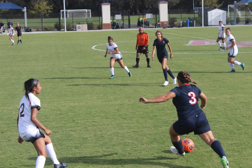 Defender Josie Baca takes possession of the ball from Sacramento City College players.