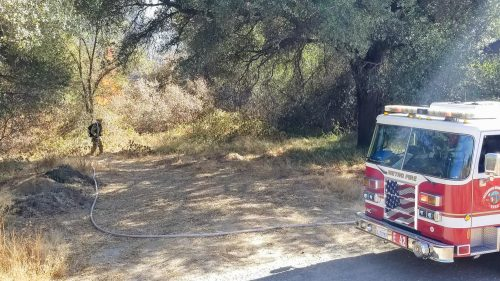Metro firefighters contain an estimated 50 square foot fire that started from unknown causes near the trail that runs by the American River College campus on Oct. 13. (Photo by Patrick Hyun Wilson)