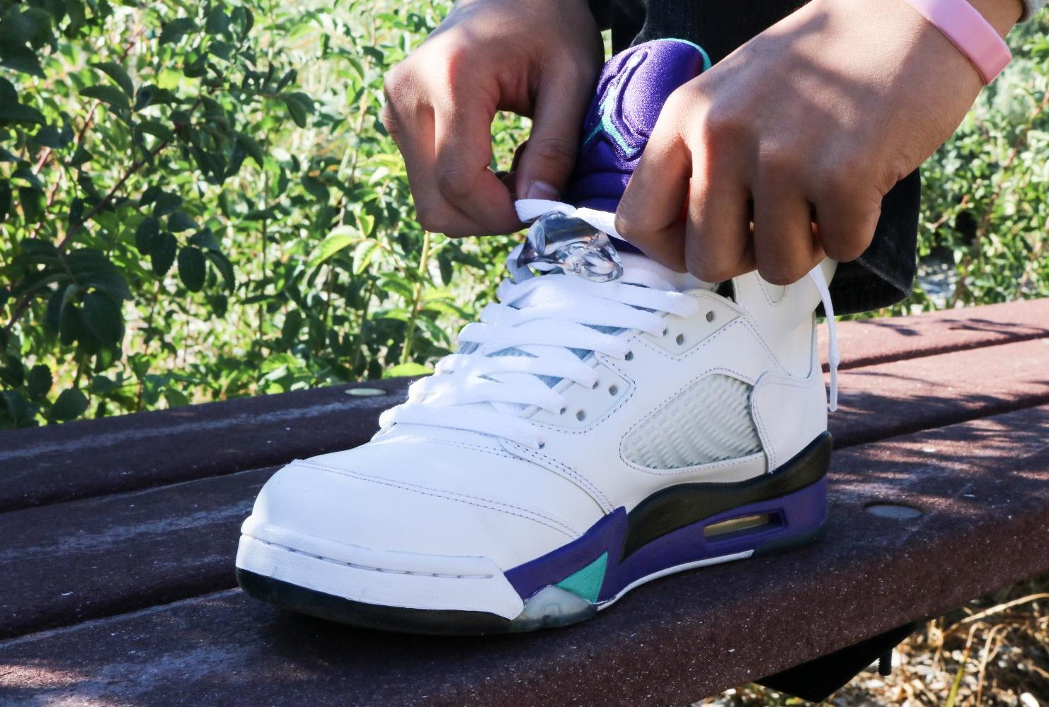 """""""I camped out at six in the morning at the mall to get Fire Red 5s."""" – Joey Ngyun   Automotive Technology   Air Jordan 5 Retro """"Grape"""" (Photo by Felix Oliveros)"""