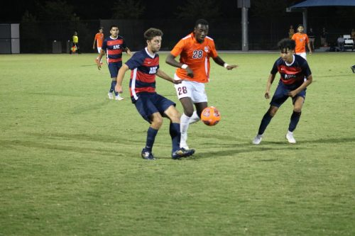 Two American River College soccer players (left to right) Miguel Jurado and Renzo Bozzalla intercept the ball from Jubilee Emojong, a Consumes River College player, at ARC on Sept. 25, 2018. (Photo by Hameed Zargry)