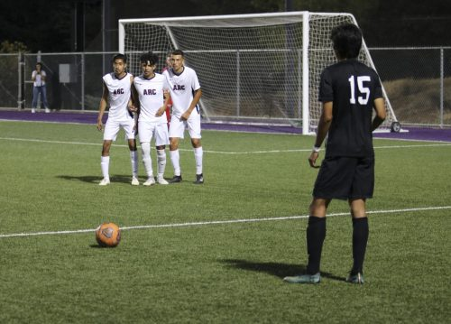 Folsom Lake College defender Eddie Ramirez takes a free kick as (left to right) Pedro Hernandez, Miguel Jurado and Santiago Moreno line up ten yards away to block the shot in the first half. ARC lost to FLC 3-1 on Oct. 4, 2018. (Photo by Gabe Carlos)