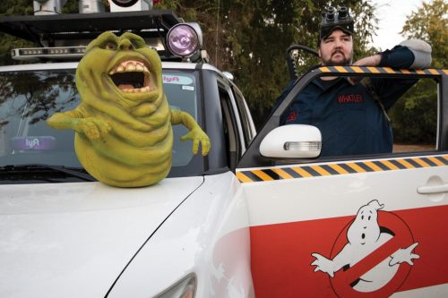 Sacramento Ghostbusters founder Andrew Whatley poses with his Ecto-1 model car and his slimer prop on Oct. 11, 2018. The Sacramento Ghostbusters is a cosplay non-profit organization that attends charity events to help raise awarness of the charity. (Photo by Ashley Hayes-Stone)