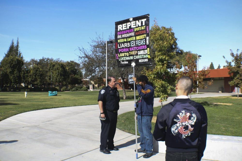 Captain Chris Day from the Los Rios Police Department speaks to a protester in front of the Student Center on Oct. 31, 2018. (Photo by Tracy Holmes)
