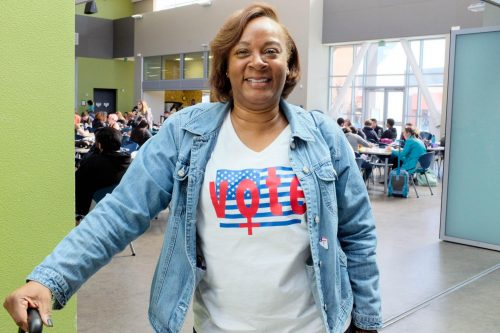 "Michele Gobern, Drug and Alcohol Social Work major, sports a ""Vote"" shirt on Election Day in the Student Center at American River College on Nov. 6, 2018. (Photo by Patrick Hyun Wilson)"