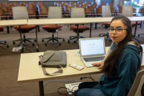 Student Senate president Rebeca Rico-Chavez sits in the empty meeting room where, ASB meets each week on Nov. 6, 2018. (Photo Illustration by Patrick Hyun Wilson)