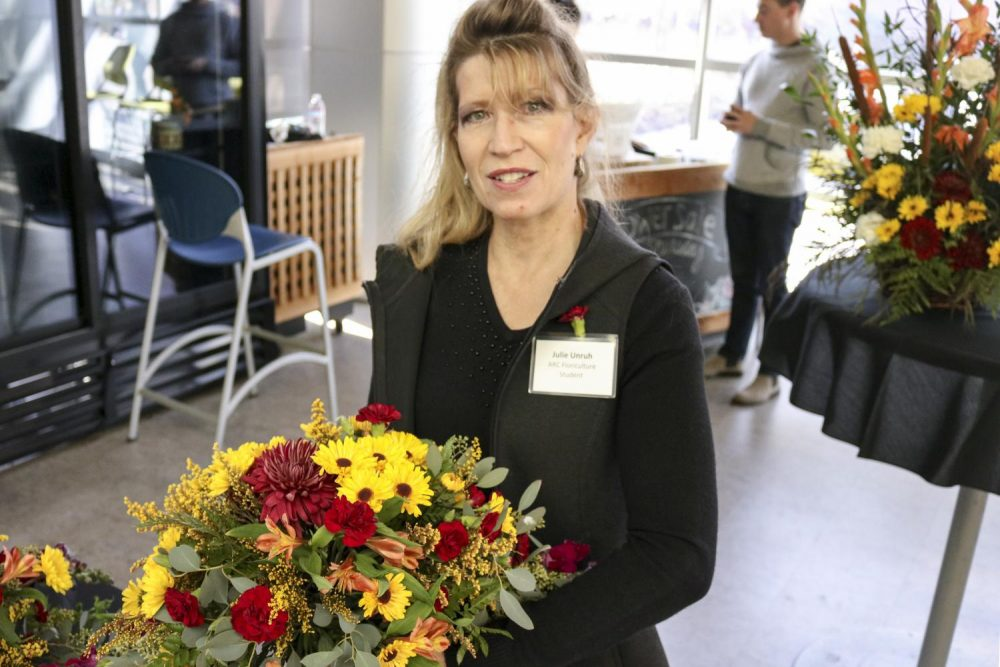 Floriculture student Julie Unruh, sells flowers in the Student Center at American River College on Nov. 08, 2018. (Photo by Christian Sutton)