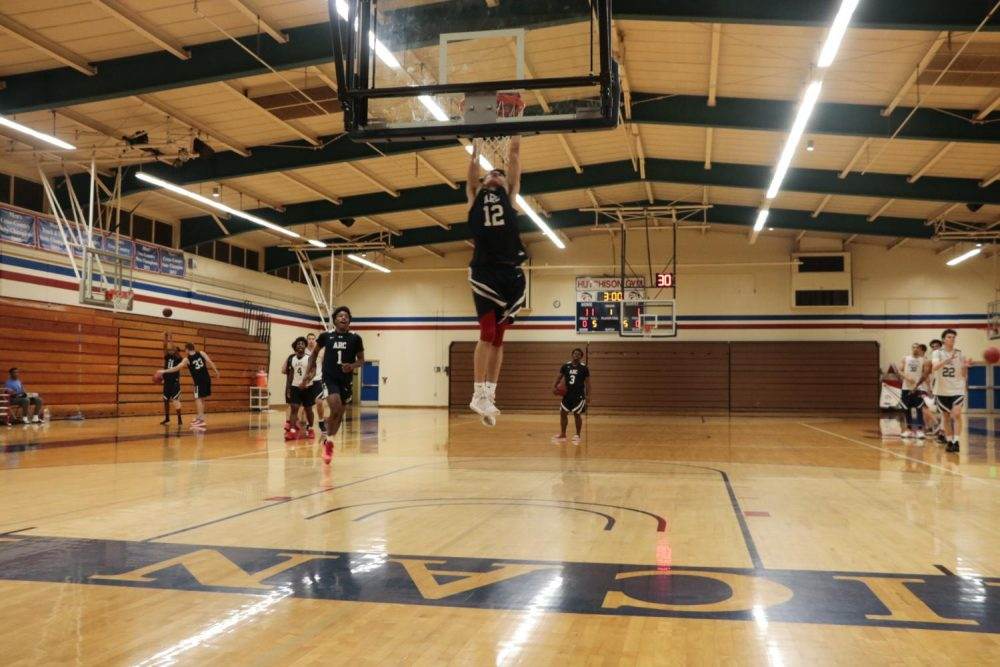 Sophomore L.J. Smith dunks at practice during warmups as the Beavers prepare for the new season at American River College on Oct. 30, 2018. (Photo By Felix Oliveros)