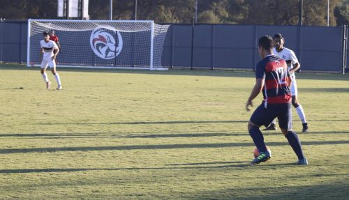American River freshman, Jeime Reynoso dribbles the ball away from San Joaquin Delta players to be able to make a play for his teammates. ARC ties SJD 0-0. (Photo by Hameed Zargry)