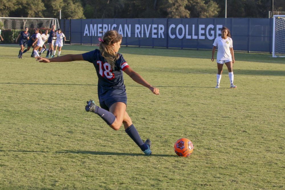 Savannah Tijerino-Santos, team captain and forward on the American River College women's soccer team, takes a shot on Delta Colege's goal on Oct. 19, 2018. (Photo by Jennah Booth)