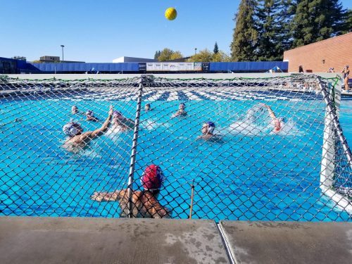 Students in men's water polo practice scoring goals in American River College's pool by the gym on Nov. 7, 2018. (Photo by Hannah Yates)