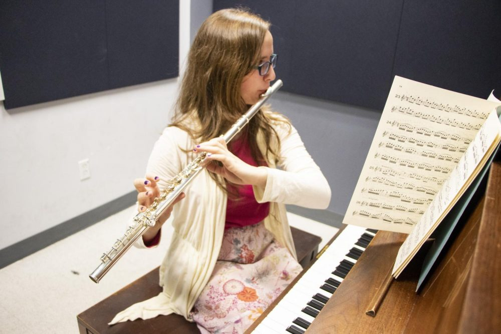 Music major Rebeca Stroup practices playing the flute in one of Music Department's practice room at American River College on Nov. 13, 2018. (Photo by Ashley Hayes-Stone)
