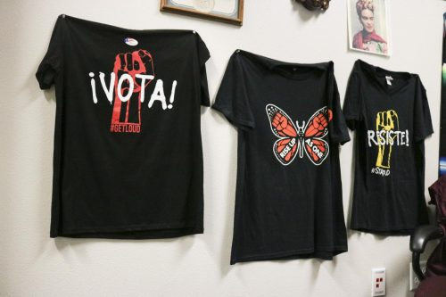 "T-shirts that read ""Vota"", ""Rise up as One"" and ""Resist"" hang in the Puente counseling office in the Hub to raise awareness for immigrants rights and presence on campus at American River College on Nov. 26, 2018. (Photo by Christian Sutton)"