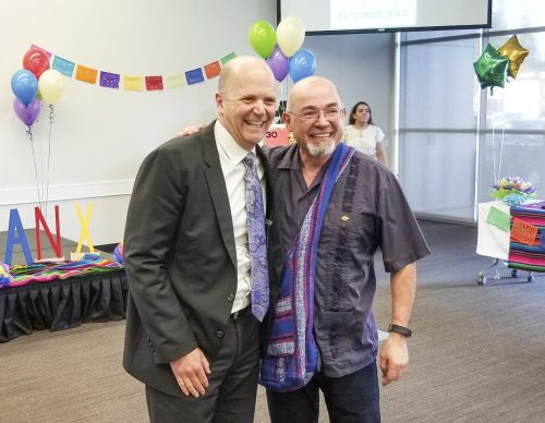 Thomas Greene, President of American River College (left), congratulates Manuel Ruedas, Puente Project coordinator and Trio (STEM) counselor (right), at his retirement ceremony on Nov. 30, 2018 in the Community Rooms at American River College. (Photo by Christian Sutton)