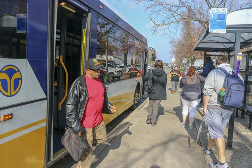 Students commute by bus to arrive at American River College while some leave campus on Dec. 11, 2018. Using public transportation is one of the many ways to help reduce emissions. (Photo by Hameed Zargry)