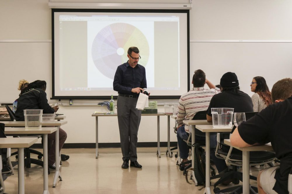 Professor Brian Knirk discussing the wines they are tasting in his Hospitality Management class at American River College Nov. 5, 2018. (Photo by Hannah Yates)